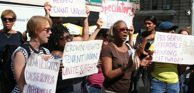 Tenant union activists demonstrating in Crown Heights, Brooklyn, for affordable housing.